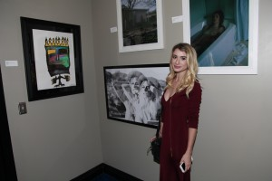 Artist Joyce Downing by her photograph of Cali Young