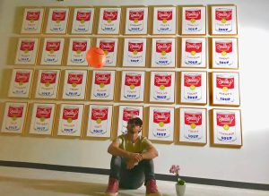 Matt Smiley in Front of Soup Cans